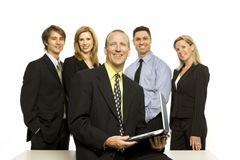 bigstockphoto_Business_People_Near_Desk_1600784